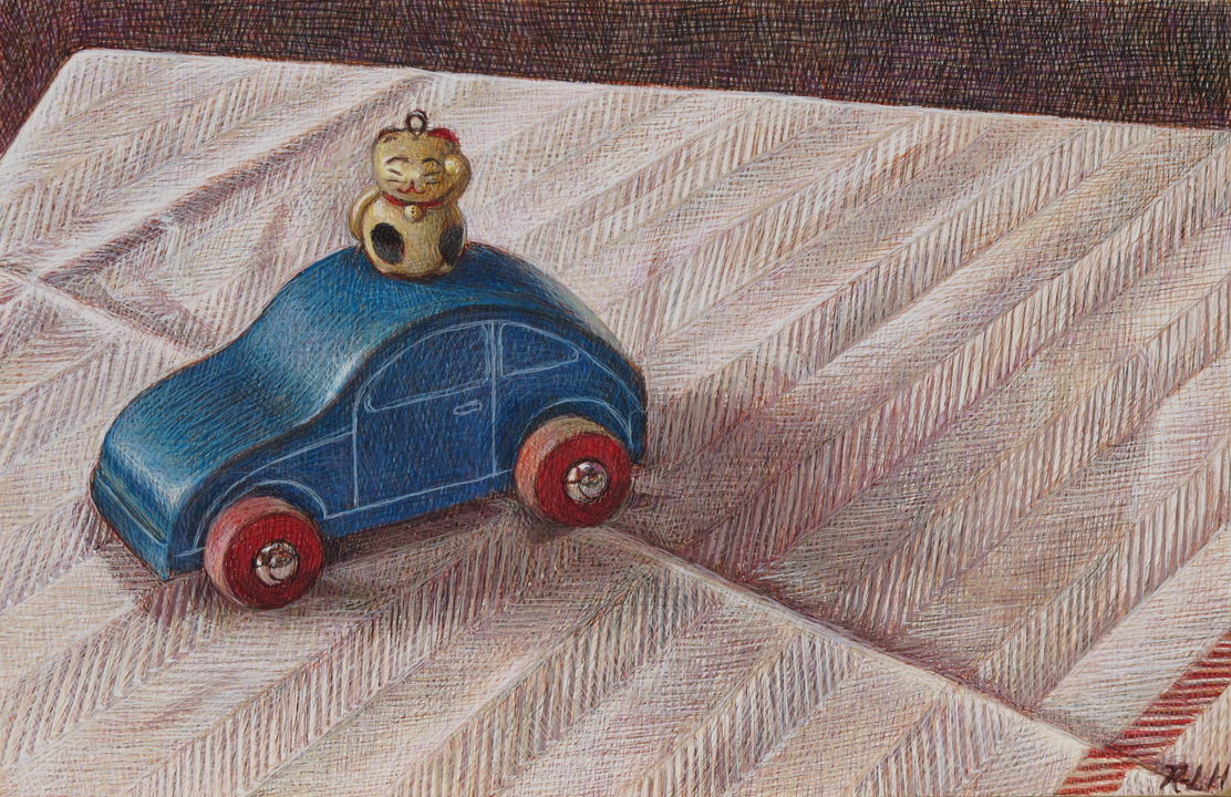 Chinese Charm on a Toy Car
